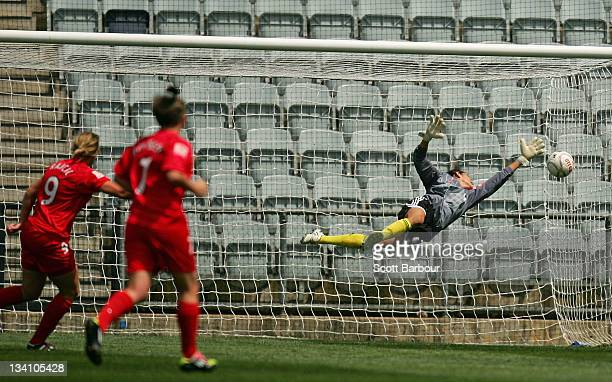 Marijana Rajcic of United scores a goal as goalkeeper Allison Lipsher of Sydney FC dives for the ball during the round six WLeague match between...