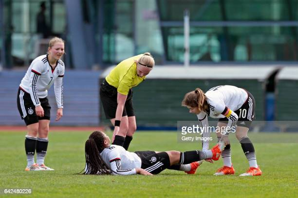 Marije Deuring sees Michelle Klostermann of Germany U16 Girls injured observed by Pauline Wimmer and Pauline Berning of Germany U16 Girls during the...