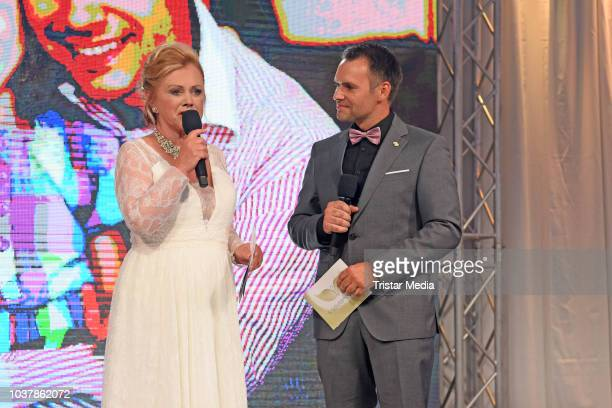Marijke Amado and Daniel Kemp seen on stage during the 6th SchutzengelGala at The Westin Hotel on September 22 2018 in Leipzig Germany