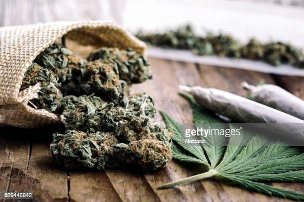 marijuana buds with marijuana joints - weed stock photos and pictures