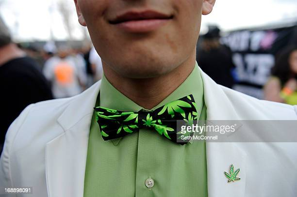 A marijuana enthusiast displays his marijuana themed bow tie and pin while wondering the concourse during the High Times US Cannabis Cup at the Exdo...