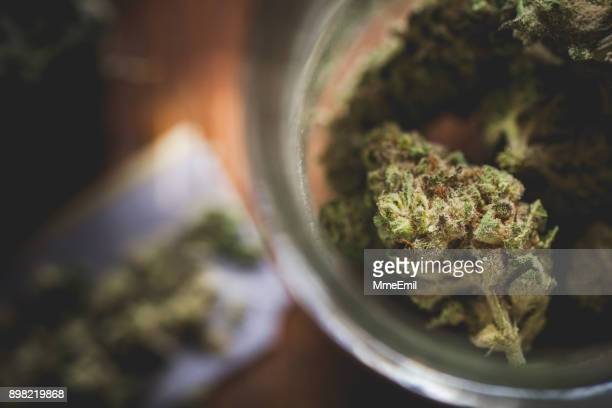 marijuana in a jar. cannabis joint. medical or recreative - marijuana stock photos and pictures