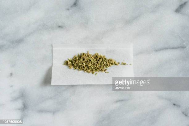 marijuana in rolling paper - rolling stock pictures, royalty-free photos & images