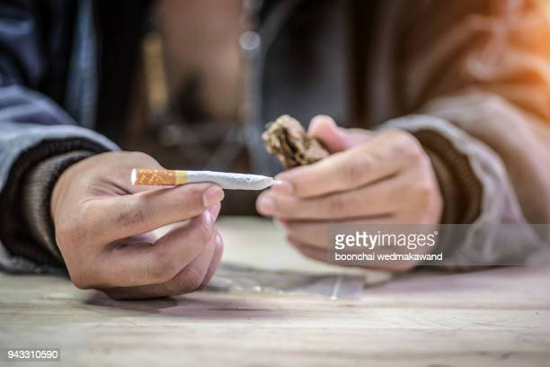 marijuana joint in the hand, drugs concept - meth pipe stock photos and pictures