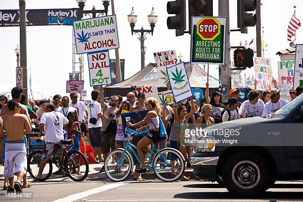 marijuana legalisation protesters on busy street. - legalization stock pictures, royalty-free photos & images