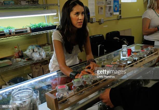 Marijuana saleswoman Marissa Dodd talks to a customer about different varieties of marijuana available at the Dr Reefer marijuana dispensary April 20...