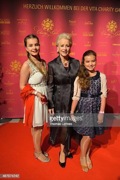 Marika Kilius granddauthers Lola and Lilli attend the VITA Charity Gala at the Kurhaus on October 11 2014 in Wiesbaden Germany