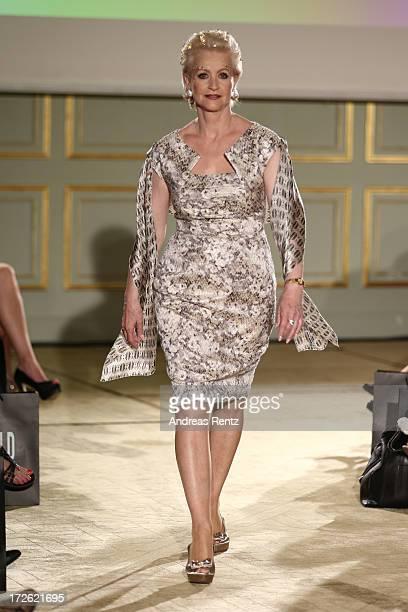 Marika Kilius walks the runway at the Sava Nald Show during the MercedesBenz Fashion Week Spring/Summer 2014 at Hotel Adlon on July 4 2013 in Berlin...