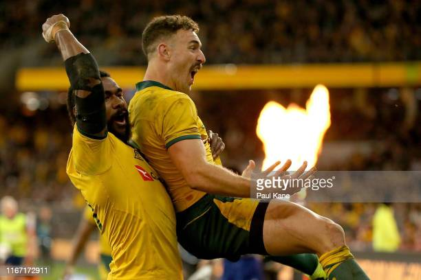 Marika Koroibete and Nic White of the Wallabies celebrate a try during the 2019 Rugby Championship Test Match between the Australian Wallabies and...