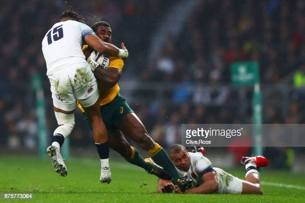Marika Koroibete of Australia is tackled by Anthony Watson of England during the Old Mutual Wealth Series match between England and Australia at...