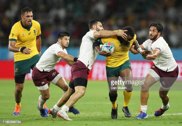 Marika Koroibete of Australia is tackled by Davit Kacharava and Giorgi Kveseladze of Georgia during the Rugby World Cup 2019 Group D game between...