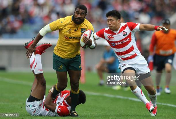 Marika Koroibete of Australia is tackled by Kotaro Matsushima and Rikiya Matsuda during the rugby union international match between Japan and...