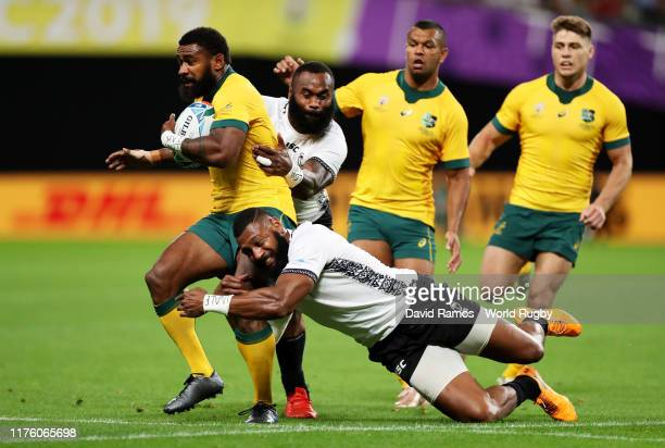 Marika Koroibete of Australia is tackled by Semi Radradra and Waisea Nayacalevu of Fiji during the Rugby World Cup 2019 Group D game between...