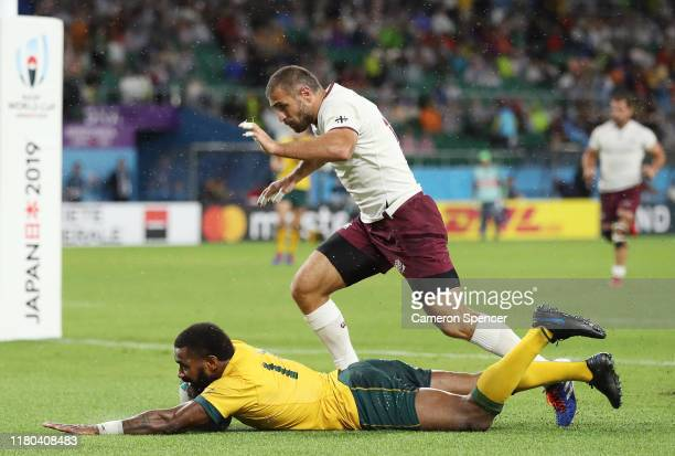 Marika Koroibete of Australia scores his teams second try as Lasha Khmaladze of Georgia reacts during the Rugby World Cup 2019 Group D game between...