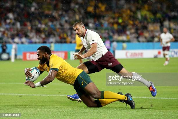 Marika Koroibete of Australia scores his teams second try past Lasha Khmaladze of Georgia during the Rugby World Cup 2019 Group D game between...