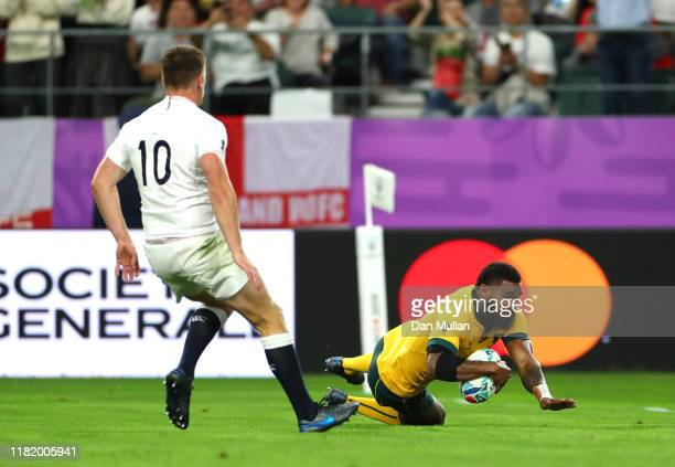 Marika Koroibete of Australia touches down to score his team's first try as Owen Farrell of England runs in during the Rugby World Cup 2019 Quarter...