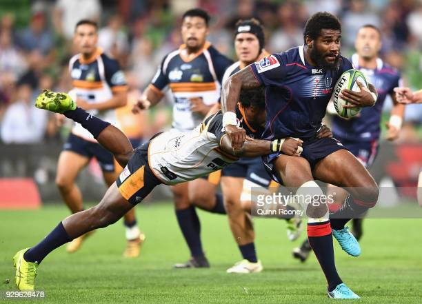 Marika Koroibete of the Rebels breaks through a tackle during the round four Super Rugby match between the Rebels and the Brumbies at AAMI Park on...