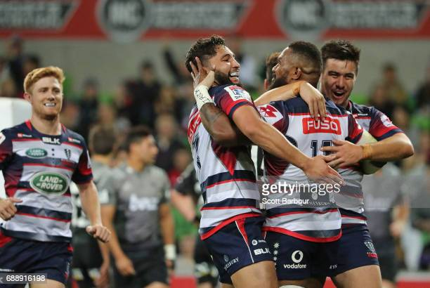 Marika Koroibete of the Rebels is congratulated by his Nic Stirzaker and Colby Fainga'a after scoring a try during the round 14 Super Rugby match...