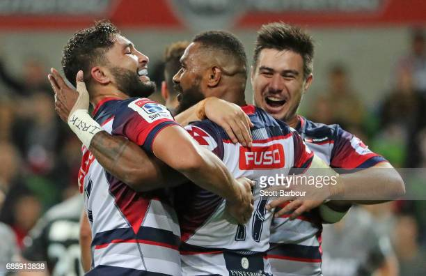 Marika Koroibete of the Rebels is congratulated by his teammates after scoring a try during the round 14 Super Rugby match between the Rebels and the...