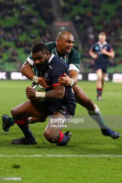 Marika Koroibete of the Rebels is tackled by Cornal Hendricks of the Bulls during the round 14 Super Rugby match between the Rebels and Bulls at AAMI...
