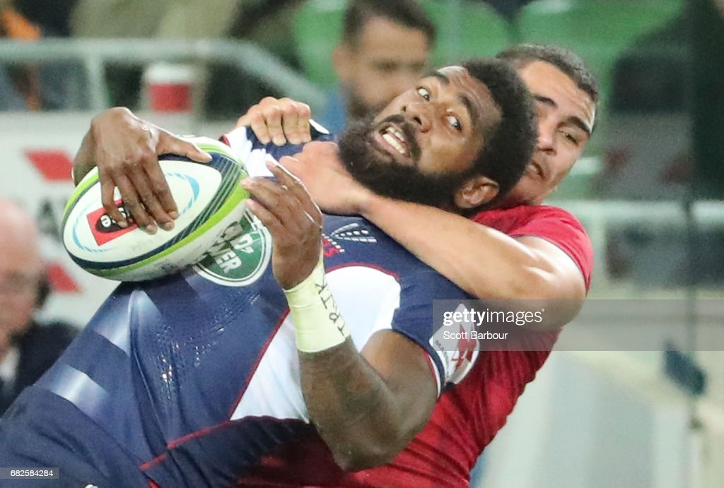 Marika Koroibete of the Rebels is tackled during the round 12 Super Rugby match between the Melbourne Rebels and the Queensland Reds at AAMI Park on May 13, 2017 in Melbourne, Australia.