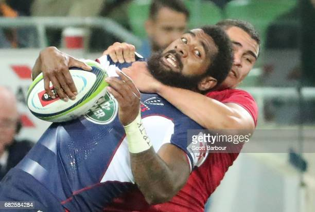 Marika Koroibete of the Rebels is tackled during the round 12 Super Rugby match between the Melbourne Rebels and the Queensland Reds at AAMI Park on...