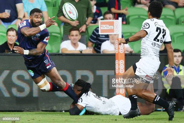 Marika Koroibete of the Rebels passes the ball during the round six Super Rugby match between the Melbourne Rebels and the Sharks at AAMI Park on...