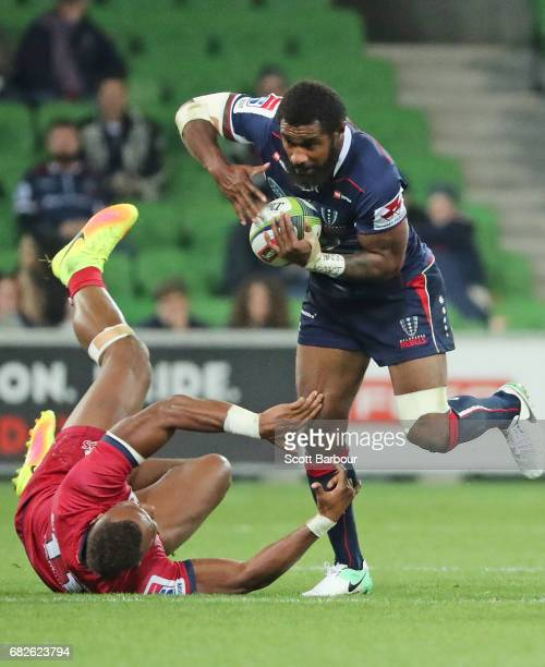 Marika Koroibete of the Rebels runs with the ball during the round 12 Super Rugby match between the Melbourne Rebels and the Queensland Reds at AAMI...
