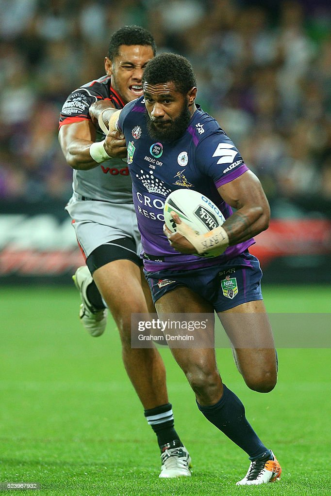 Marika Koroibete of the Storm (R) breaks through a tackle during the round eight NRL match between the Melbourne Storm and the New Zealand Warriors at AAMI Park on April 25, 2016 in Melbourne, Australia.