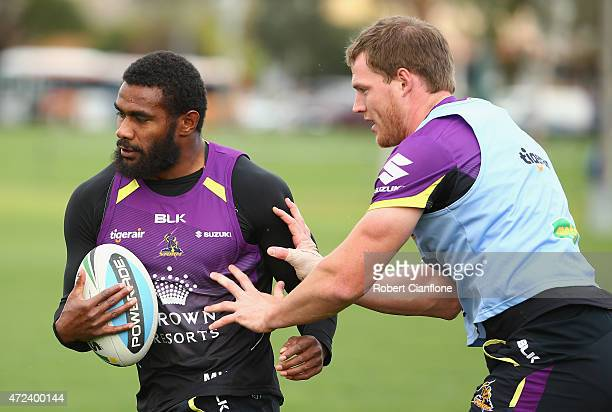 Marika Koroibete of the Storm is challenged by Tim Glasby during a Melbourne Storm NRL training session at Gosch's Paddock on May 7 2015 in Melbourne...
