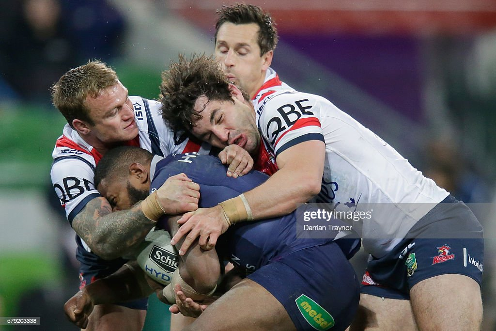 Marika Koroibete of the Storm is tackled during the round 20 NRL match between the Melbourne Storm and the Sydney Roosters at AAMI Park on July 23, 2016 in Melbourne, Australia.