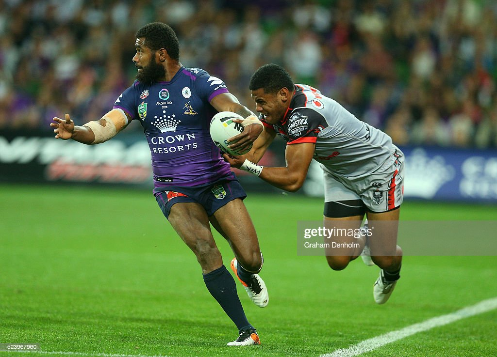 Marika Koroibete of the Storm (L) is tackled during the round eight NRL match between the Melbourne Storm and the New Zealand Warriors at AAMI Park on April 25, 2016 in Melbourne, Australia.