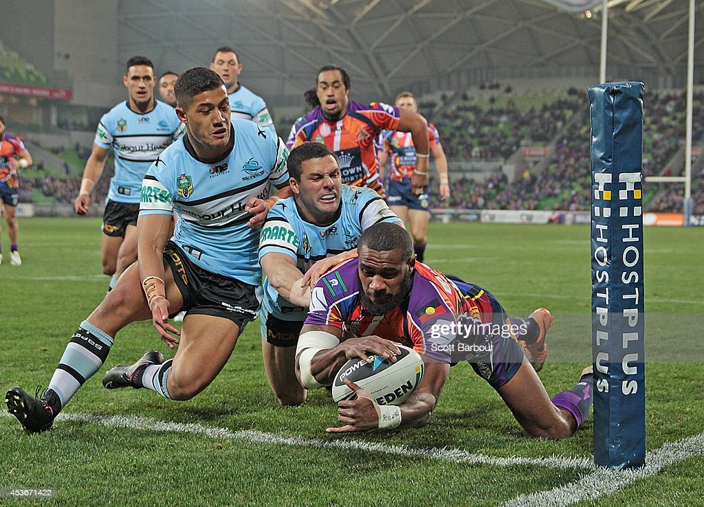 Marika Koroibete of the Storm scores the first try of the match during the round 23 NRL match between the Melbourne Storm and the Cronulla Sharks at AAMI Park on August 16, 2014 in Melbourne, Australia.