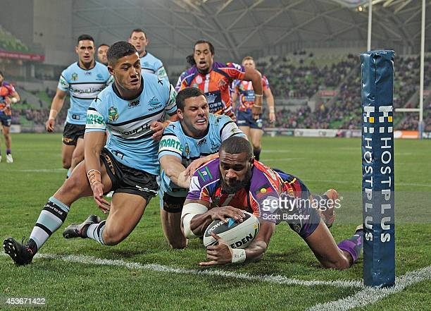 Marika Koroibete of the Storm scores the first try of the match during the round 23 NRL match between the Melbourne Storm and the Cronulla Sharks at...