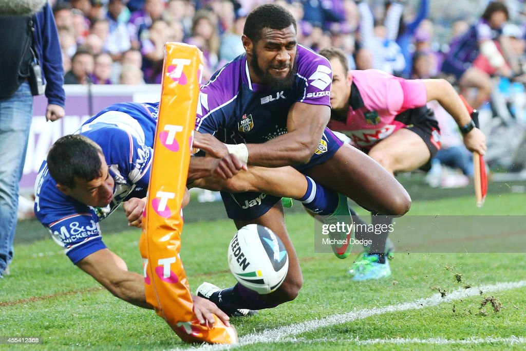 Marika Koroibete of the Storm stops Corey Thompson of the Bulldogs from scoring a try during the NRL 2nd Elimination Final match between the Melbourne Storm and the Canterbury Bankstown Bulldogs at AAMI Park on September 14, 2014 in Melbourne, Australia.