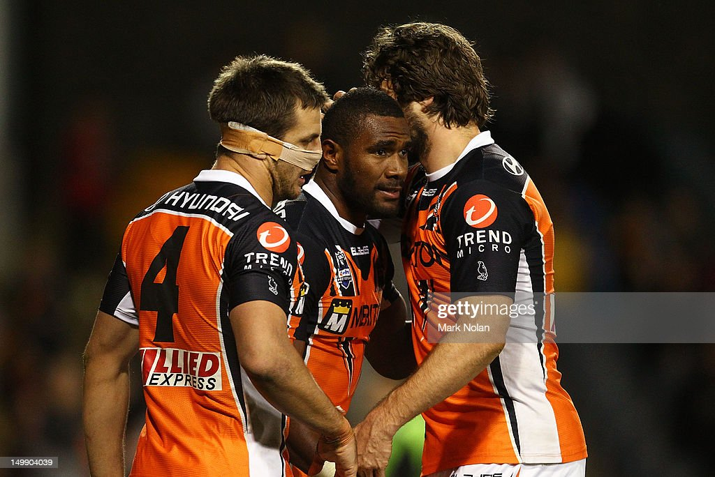 Marika Koroibete of the Tigers is congratulated after scoring during the round 22 NRL match between the Wests Tigers and the Parramatta Eels at Campbelltown Sports Stadium on August 6, 2012 in Sydney, Australia.