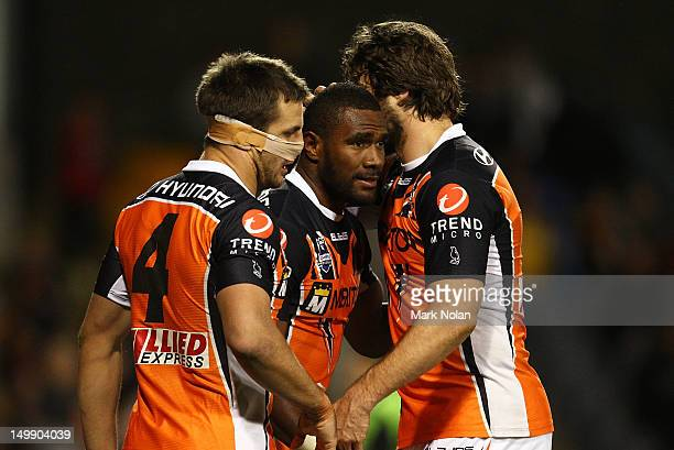 Marika Koroibete of the Tigers is congratulated after scoring during the round 22 NRL match between the Wests Tigers and the Parramatta Eels at...