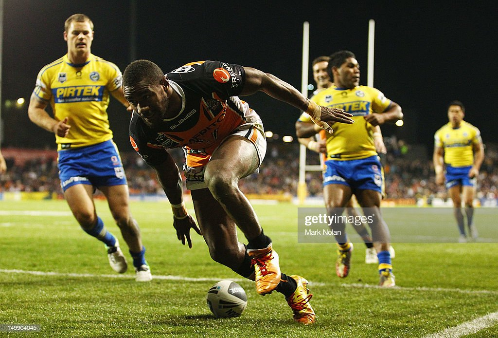 Marika Koroibete of the Tigers scores during the round 22 NRL match between the Wests Tigers and the Parramatta Eels at Campbelltown Sports Stadium on August 6, 2012 in Sydney, Australia.