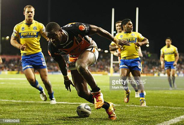 Marika Koroibete of the Tigers scores during the round 22 NRL match between the Wests Tigers and the Parramatta Eels at Campbelltown Sports Stadium...