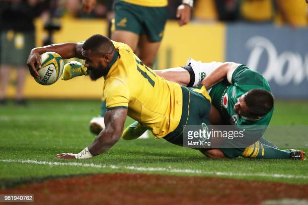 Marika Koroibete of the Wallabies beats the tackle of Johnny Sexton of Ireland to score during the Third International Test match between the...