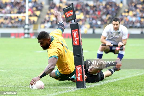 Marika Koroibete of the Wallabies dives over to score a try during the Bledisloe Cup match between the New Zealand All Blacks and the Australian...
