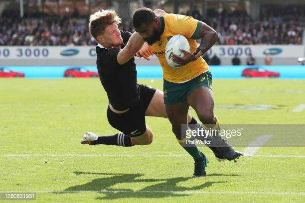 Marika Koroibete of the Wallabies is tackled by Jordie Barrett of the All Blacks during the Bledisloe Cup match between the New Zealand All Blacks...