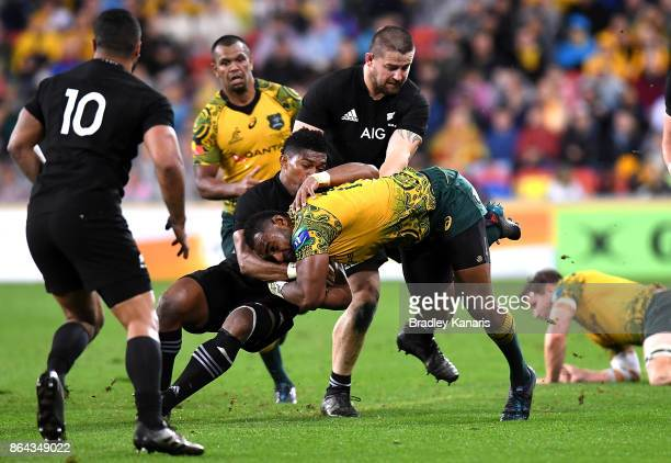 Marika Koroibete of the Wallabies is tackled during the Bledisloe Cup match between the Australian Wallabies and the New Zealand All Blacks at...