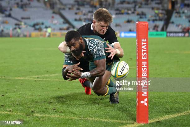 Marika Koroibete of the Wallabies loses the ball whilst being tackled by Jordie Barrett of the All Blacks over the try-line during the 2020...