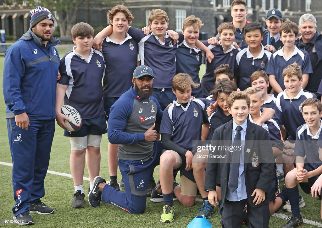 Marika Koroibete of the Wallabies poses for a photo with students during an Australian Wallabies media opportunity at Melbourne Grammar School on June 14, 2018 in Melbourne, Australia.