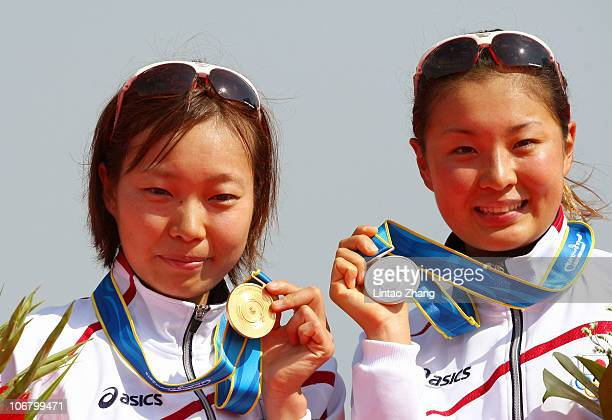 Mariko Adachi of Japan and Akane Tsuchihashi of Japan pose with the medals won in the Women's Individual Triathlon at the Triathlon Venue during day...
