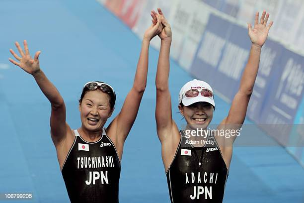 Mariko Adachi of Japan celebrates with teammate Akane Tsuchihashi of Japan after winning the gold and silver medals respectively in the Women's...