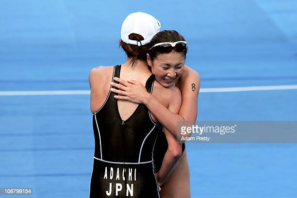 Mariko Adachi of Japan hugs teammate Akane Tsuchihashi of Japan after winning the gold and silver medals respectively in the Women's Individual...