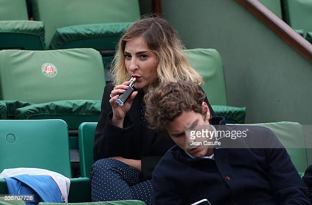 Marilou Berry smokes an electronic cigarette during day 8 of the 2016 French Open held at RolandGarros stadium on May 29 2016 in Paris France
