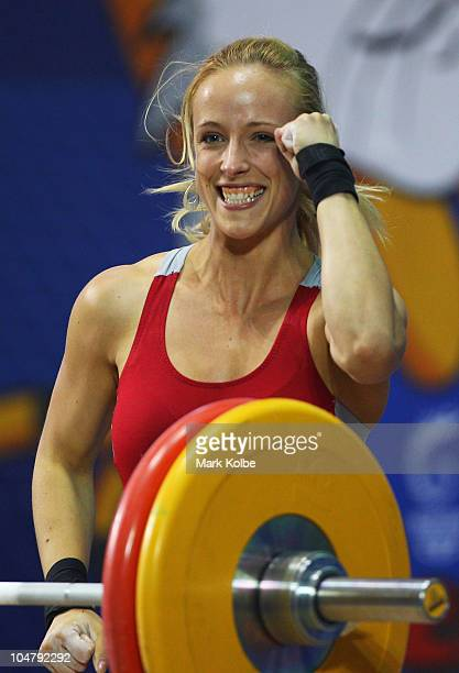 Marilou Dozois-Prevost of Canada celebrates a successful attempt in the Women's 53kg weightlifting final during day two of the Delhi 2010...